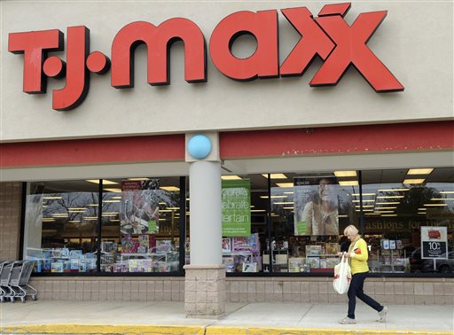 55736d17f79b 17, 2009 file photo, a customer walks past a T.J. Maxx store in Boston. TJX  Cos., the owner of T.J. Maxx, Marshalls and Home Goods stores, on  Wednesday, ...