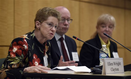 Dr. Ellen Wright Clayton, left, chair of the Committee on Diagnostic Criteria for Myalgic Encephalomyelitis/Chronic Fatigue Syndrome speaks during an open meeting at the Institute of Medicine in Washington, Tuesday, Feb. 10, 2015. Chronic fatigue syndrome is a real and serious disease that needs a new name to reflect that _ and a straightforward way to diagnose the illness, a government advisory group declares. The new name, Systemic Exertion Intolerance Disease, better reflects the hallmark symptoms of this mysterious illness, namely, that patients can be wiped out by exertion. Committee member Peter Rowe, center, and Lucinda Bateman, right, listen. (AP Photo/Susan Walsh)