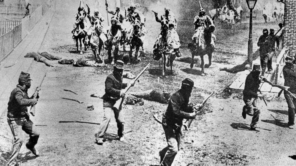 """This 1914 file photo shows a scene from D.W. Griffith's """"Birth of a Nation"""" movie depicting Ku Klux Klan members riding horses against soldiers, filmed in the Hollywood section of Los Angeles. Based on Thomas Dixon's novel, """"The Clansman,"""" it was set in the American Civil War. Earlier films often lasted less than an hour and were completed within days. """"Birth of a Nation"""" took six months to produce, had a running time of 195 minutes and employed hundreds of actors. In 1992, the Library of Congress added Griffith's work to the National Film Registry, calling it a """"controversial, explicitly racist, but landmark American film masterpiece."""" (AP Photo)"""