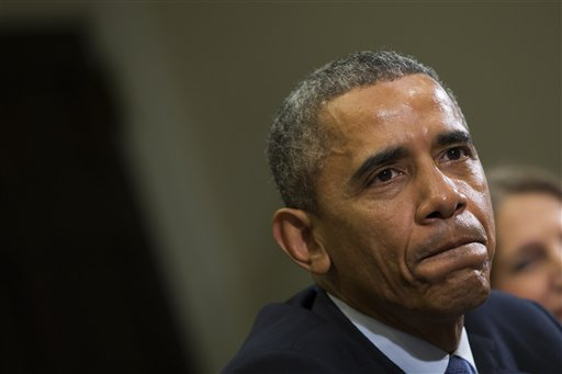 President Barack Obama pauses as he delivers remarks during a meeting with people that wrote him letters explaining how they benefited from the Affordable Care Act in the Roosevelt Room of the White House, on Tuesday, Feb. 3, 2015, in Washington. Obama also condemned the execution of Jordanian Air Force pilot First Lt. Moaz al-Kasasbeh by the Islamic State group. (AP Photo/Evan Vucci)