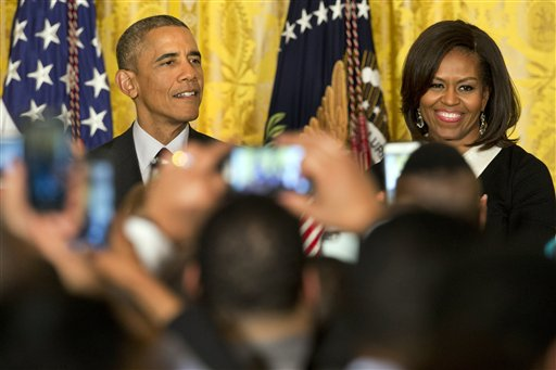 President Barack Obama, left, speaks next to first lady Michelle Obama during a reception in recognition of African American History Month in the East Room of the White House Washington, Thursday, Feb. 26, 2015. (AP Photo/Jacquelyn Martin)