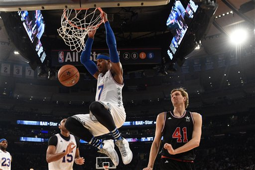 East Team's Carmelo Anthony (7), of the New York Knicks, scores a basket during the second half of NBA All-Star basketball game, Sunday, Feb. 15, 2015, in New York. (AP Photo/Bob Donnan, Pool)