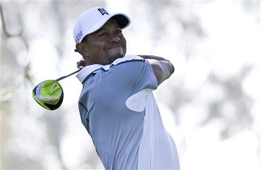 Tiger Woods watches his tee shot head far to the right on the 11th hole of the north course at Torrey Pines during the first round of the Farmers Insurance Open golf tournament Thursday, Feb. 5, 2015, in San Diego. (AP Photo/Lenny Ignelzi)