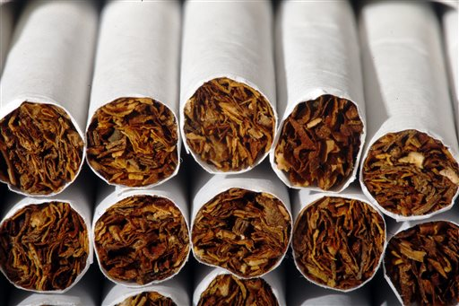 This Tuesday, July 15, 2014 photo shows the tobacco in cigarettes in Philadelphia. A study ties a host of new diseases to smoking, and says an additional 60,000 to 120,000 deaths each year in the United States are probably due to tobacco use. The study by the American Cancer Society and several universities is published in the Thursday, Feb 12, 2015 edition of the New England Journal of Medicine. It looks beyond lung cancer, heart disease and other conditions already tied to smoking and adds breast cancer, prostate cancer and even routine infections to the list. (AP Photo/Matt Rourke)