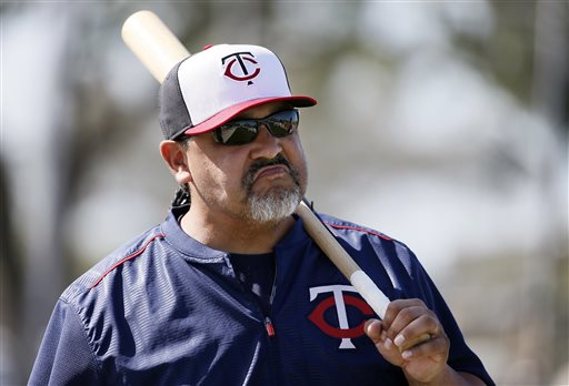 In this Tuesday, March 3, 2015, file photo, Minnesota Twins bullpen coach Eddie Guardado talks with a player standing nearby during a workout at baseball spring training in Fort Myers, Fla. Long before any of that major league money starts landing in their bank accounts, most players are in a similar spot as everyone else in the regular workforce. Twins bullpen coach Eddie Guardado gained that perspective at a bait shop in his Stockton, California when his major league career was just beginning.  (AP Photo/Tony Gutierrez, File)