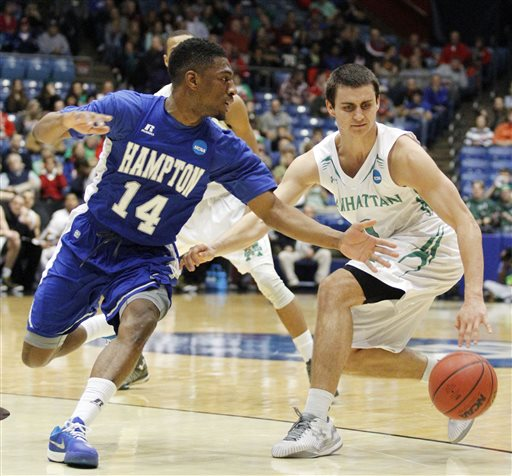 Hampton's Brian Darden (14) tries to knock the ball away from Manhattan's Shane Richards in the first half of a first-round NCAA tournament basketball game Tuesday, March 17, 2015 in Dayton, Ohio. (AP Photo/Skip Peterson)