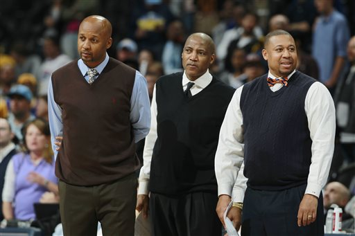 """In this April 16, 2014, file photo, from left, Denver Nuggets head coach Brian Shaw and his assistant coaches Lester Conner and Melvin Hunt look on against the Golden State Warriors in the fourth quarter of the Warriors' 116-112 victory in an NBA basketball game in Denver. The Nuggets have fired coach Brian Shaw after 1½ seasons. General manager Tim Connelly said in a statement Tuesday, March 3, 2015: """"You won't find a better guy than Brian and he is one of the brightest basketball minds I've ever been around. Unfortunately things didn't go as we hoped, but we know with his basketball acumen that he has a very bright future ahead of him."""" Assistant coach Melvin Hunt will serve as interim coach. (AP Photo/David Zalubowski, File)"""