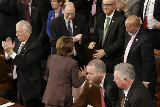 """House Minority Leader Nancy Pelosi of Calif. turns to talk to her colleagues in the House chamber of Capitol Hill in Washington, Tuesday, March 3, 2015, during Israeli Prime Minister Benjamin Netanyahu's  address before a joint meeting of Congress. In a speech that stirred political intrigue in two countries, Netanyahu told Congress that negotiations underway between Iran and the U.S. would """"all but guarantee"""" that Tehran will get nuclear weapons, a step that the world must avoid at all costs. House Minority Whip Steny Hoyer of Md. is at left.  (AP Photo/J. Scott Applewhite)"""