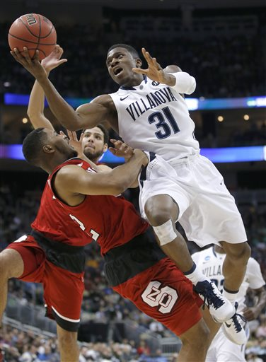 Villanova's Dylan Ennis (31) shoots over North Carolina State's Ralston Turner, front left, during the first half of an NCAA tournament third-round college basketball game, Saturday, March 21, 2015, in Pittsburgh. (AP Photo/Gene J. Puskar)