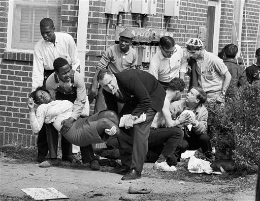 """In this March 7, 1965 file photo, S.W. Boynton is carried and another injured man tended to after they were injured when state police broke up a demonstration march in Selma, Ala. Boynton, wife of a real estate and insurance man, has been a leader in civil rights efforts. The day, which became known as """"Bloody Sunday,"""" is widely credited for galvanizing the nation's leaders and ultimately yielded passage of the Voting Rights Act of 1965. (AP Photo/File)"""