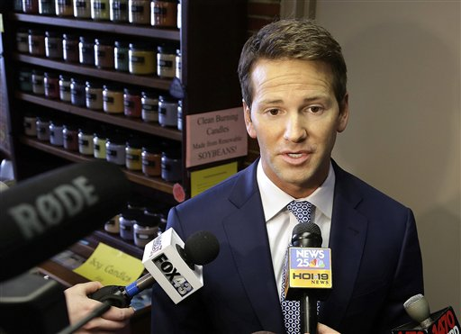In this Feb. 6, 2015 file photo, Rep. Aaron Schock, R-Ill. speaks to reporters in Peoria, Ill. Schock announced Tuesday his resignation amid questions about spending. (AP Photo/Seth Perlman, File)