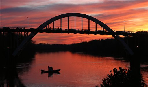 """The sun sets over the Edmund Pettus Bridge where preparations for the 50th anniversary of the civil rights march with a visit Saturday with President Barack Obama and the first family, Friday, March. 6, 2015, in Selma, Ala. This weekend marks the 50th anniversary of """"Bloody Sunday,"""" a civil rights march in which protesters were beaten, trampled and tear-gassed by police at the Edmund Pettus Bridge in Selma, Ala. (AP Photo/Butch Dill)"""