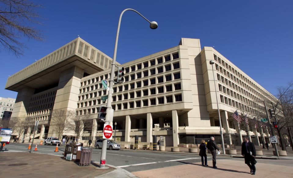 """This Feb. 3, 2012 file photo shows Federal Bureau of Investigation (FBI) headquarters in Washington. Just six blocks from the White House, the FBI's hulking headquarters overlooking Pennsylvania Avenue has long been the government building everyone loves to hate. The verdict: it's an ugly, crumbling concrete behemoth. An architectural mishap, all 2.4 million square feet of it. But in this time of tight budgets, massive deficits and the """"fiscal cliff,"""" the 38-year-old FBI headquarters building has one big thing in its favor. It sits atop very valuable real estate, an entire city block on American's Main Street midway between the U.S. Capitol and the White House. Just how valuable, the General Services Administration intends to find out. (AP Photo/Manuel Balce Ceneta, File)"""