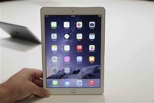 In this Oct. 16, 2014 file photo, the iPad Air 2 is displayed for journalists at Apple headquarters in Cupertino, Calif. Apple's tablet computing device, once a red-hot consumer gadget, has suffered from a steady decline in sales over the last year. (AP Photo/Marcio Jose Sanchez, File)