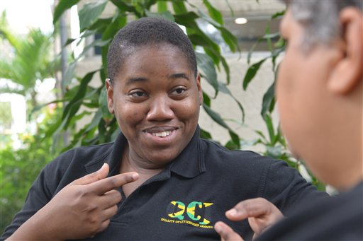 """In this March 24, 2015 photo, gay rights activist Angeline Jackson, 24, speaks with a colleague in Kingston, Jamaica. Jackson, a victim of a targeted sexual assault when she was 19, now directs the only registered lesbian and bisexual women's organization in Jamaica and is determined to help others recover from sexual crimes targeting female homosexuals, including so-called """"corrective rapes"""" intended to force them into becoming heterosexual or punish them for not fitting societal norms. (AP Photo/David McFadden)"""