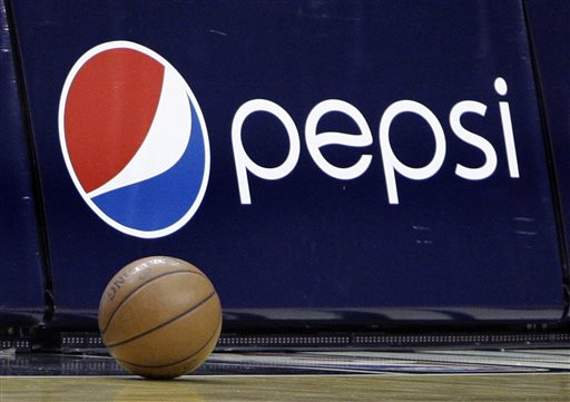 In this Oct. 7, 2009 file photo, a court side ad displays the Pepsi logo during a time out in an NBA preseason basketball game between the Orlando Magic and the Miami Heat in Orlando, Fla. The NBA on Monday, April 13, 2015 said that it's struck a new marketing partnership with Pepsico, ending a 28-year partnership with Coca-Cola. (AP Photo/John Raoux, File)