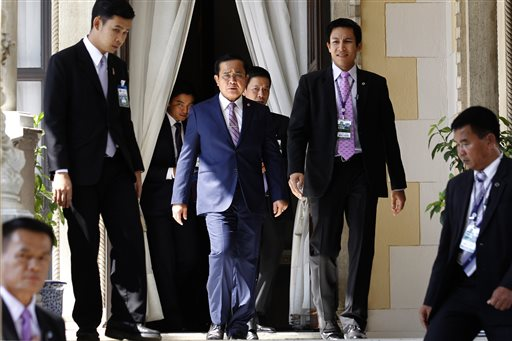 """Thailand's Prime Minister Prayuth Chan-ocha, center, arrives at Government House in Bangkok, Thailand, Thursday, April 2, 2015. Thailand's junta lifted martial law, which was imposed in the run-up to their May 22, 2014, coup -- but then quickly replaced it with another set of draconian laws innocuously called """"Article 44."""" But make no mistake -- 10 months after staging the coup, a military junta is still ruling Thailand, essentially with absolute power. (AP Photo/Sakchai Lalit)"""