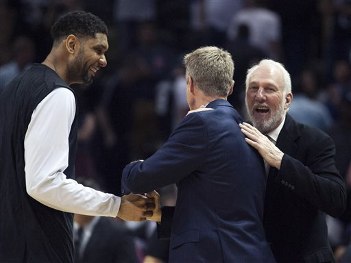 San Antonio Spurs head coach Gregg Popovich, right, and Spurs forward Tim Duncan, left, speak to Golden State Warriors head coach Steve Kerr after an NBA basketball game, Sunday, April 5, 2015, in San Antonio. San Antonio won 107-92. (AP Photo/Darren Abate)