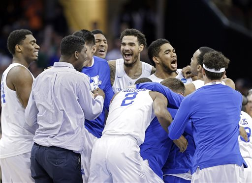 Kentucky players celebrate after a 68-66 win over Notre Dame in a college basketball game in the NCAA men's tournament regional finals, Saturday, March 28, 2015, in Cleveland. The 38-0 Wildcats advanced to the Final Four. (AP Photo/Tony Dejak)