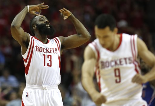 Houston Rockets guard James Harden (13) and guard Pablo Prigioni (9) react to a Harden 3-pointer against the Los Angeles Clippers during Game 2 in a second-round NBA basketball playoff series Wednesday, May 6, 2015, in Houston. The Rockets won 115-109. (AP Photo/Houston Chronicle, James Nielsen)