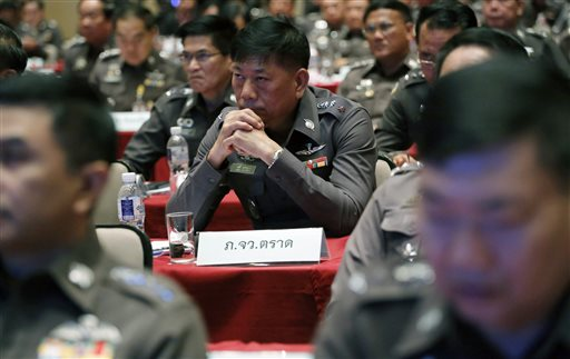 Thai policemen listen to Thai Police chief Gen. Somyot Poompanmoung during a meeting about Anti Human Trafficking at the police headquarters in Bangkok, Thailand, Friday, May 8, 2015. Thailand's national police chief said a powerful mayor was arrested Friday and that more than 50 police officers were under investigation in the country's widening human-trafficking scandal. (AP Photo/Sakchai Lalit)