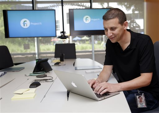 In this April 24, 2015 photo, Nick Fox, Vice President for Communications Products at Google, prepares a presentation on Project Fi, in Mountain View, Calif.  Project Fi is Google's recently launched attempt to usher in new ways to keep smartphones online while lowering the cost for streaming video, listening to music, getting directions and searching for information. (AP Photo/Marcio Jose Sanchez)