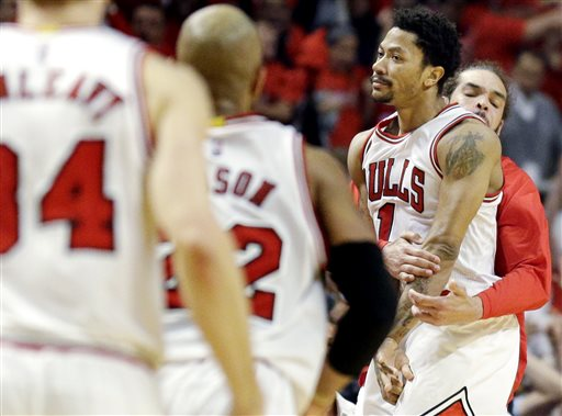 Chicago Bulls guard Derrick Rose (1) celebrates with Joakim Noah, right, and Taj Gibson after scoring the game-winning 3-point basket during the second half of Game 3 in a second-round NBA basketball playoff series against the Cleveland Cavaliers in Chicago, Friday, May 8, 2015. The Bulls won 99-96. (AP Photo/Nam Y. Huh)