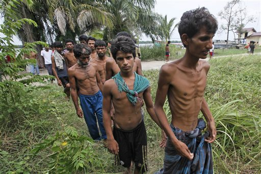 Bangladeshi migrants walk toward a temporary shelter upon arrival at Kuala Langsa Port in Langsa, Aceh province, Indonesia, Friday, May 15, 2015. Hundreds of Bangladeshi and ethnic Rohingya migrants have landed on the shores of Indonesia and Thailand after being adrift at sea for weeks, authorities said Friday. They are among the few who have successfully sneaked past a wall of resistance mounted by Southeast Asian countries who have made it clear the boat people are not welcome. (AP Photo/Binsar Bakkara)