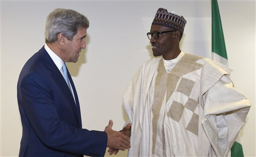 U.S. Secretary of State John Kerry, left, talks with newly inaugurated Nigerian President Muhammadu Buhari,  before the start of a formal meeting near Eagle Square in Abuja, Nigeria, Friday, May 29, 2015. (AP Photo/Susan Walsh, Pool)