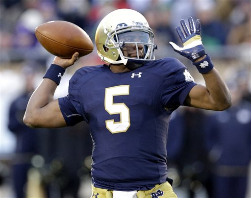 In this Saturday, Nov. 15, 2014 file photo, Notre Dame quarterback Everett Golson (5) looks to a pass during the first half of an NCAA college football game against Northwestern in South Bend, Ind. Florida State coach Jimbo Fisher says he has met with Everett Golson about the possibility of the former Notre Dame quarterback transferring to the Seminoles, Tuesday, May 12, 2015. (AP Photo/Nam Y. Huh, File)