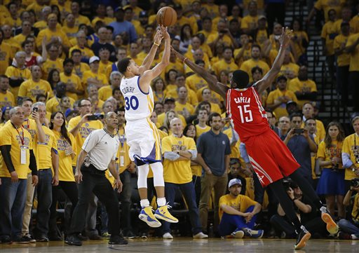 Golden State Warriors guard Stephen Curry (30) shoots against Houston Rockets center Clint Capela (15) during the first half of Game 1 of the NBA basketball Western Conference finals in Oakland, Calif., Tuesday, May 19, 2015. (AP Photo/Tony Avelar)