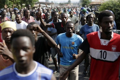 Protesters march through the Musaga district of Bujumbura, in Burundi, Monday, May 11, 2015.  Police and army negotiated with over 2000 protesters to allow delivery trucks to enter the city. One person was killed in a clash with Burundi's police on Sunday in demonstrations in the capital, Bujumbura, as the government ordered a ban on any further street protests over President Pierre Nkurunziza's bid for a third term in power. (AP Photo/Jerome Delay)
