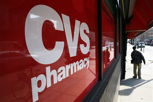 This March 25, 2014, file photo, shows a CVS store in Philadelphia. CVS Health will buy Omnicare in a deal valued at about $12.7 billion in move to expand its pharmacy services reach into assisted living and senior care facilities. (AP Photo/Matt Rourke, File)