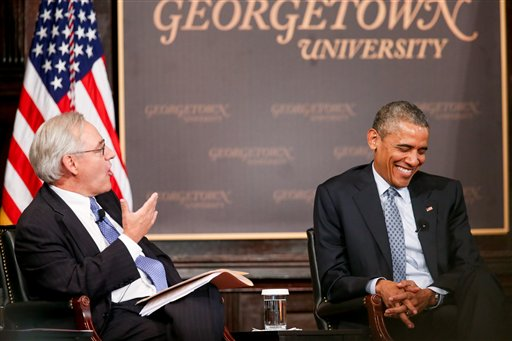 "President Barack Obama smiles as Washington Post Columnist E. J. Dionne speaks at the Catholic-Evangelical Leadership Summit on Overcoming Poverty at Gaston Hall at Georgetown University in Washington, Tuesday, May 12, 2015. The president said that ""it's a mistake"" to think efforts to stamp out poverty have failed and the government is powerless to address it. (AP Photo/Andrew Harnik)"