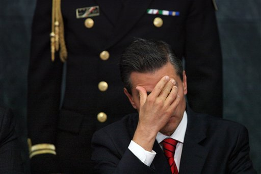 In this Wednesday, Jan. 21, 2015, file photo, Mexico's President Enrique Pena Nieto attends a ceremony promoting housing for low income families, single mothers and members of the armed forces at Los Pinos presidential residence in Mexico City. Pena Nieto has also seen his pro-business agenda derailed by allegations of corruption and the disappearance of 43 students after they were handed over by police to local drug traffickers. (AP Photo/Marco Ugarte, File)