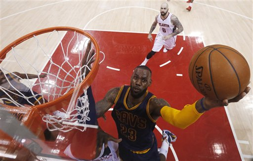 Cleveland Cavaliers forward LeBron James (23) shoots against the Atlanta Hawks during the first half in Game 1 of the Eastern Conference finals of the NBA basketball playoffs, Wednesday, May 20, 2015, in Atlanta. (AP Photo/John Bazemore)