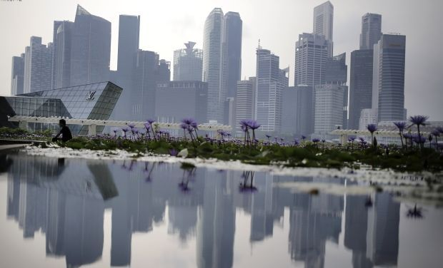 A reflection of the financial skyline of Singapore (AP Photo)