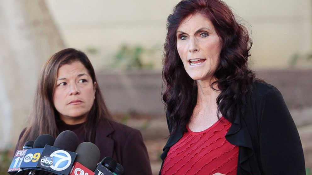 """In this Thursday, Sept. 20, 2012, file photo, Cindy Lee Garcia, one of the actresses in """"Innocence of Muslims,"""" right, and attorney M. Cris Armenta hold a news conference in Los Angeles asking a judge to issue an injunction demanding a 14-minute trailer for the film be pulled from YouTube. A federal appeals court on Monday, May 18, 2015 overturned an order for YouTube to take down the anti-Muslim film that sparked violence in the Middle East and death threats to actors. (AP Photo/Jason Redmond, File)"""