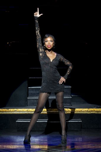 """This image released by Boneau/Bryan-Brown shows Brandy Norwood in the role of Roxie Hart during a performance of the musical """"Chicago,"""" at the Ambassador Theatre in New York. Norwood will portray Hart through June 21. (Jeremy Daniel/Boneau/Bryan-Brown via AP)"""