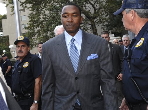 In this Oct. 2, 2007, file photo, then-New York Knicks President and coach Isiah Thomas exits Manhattan federal court following the jury decision in the sexual harassment lawsuit against him and Madison Square Garden in New York. The WNBA has been thrown into the national conversation about domestic violence and sports, and now is facing a decision involving sexual harassment.  The league is reviewing the hiring of Isiah Thomas _ once the subject of a sexual harassment lawsuit _ as president of the New York Liberty, an announcement that caught the WNBA president off guard. (AP Photo/Louis Lanzano, File)