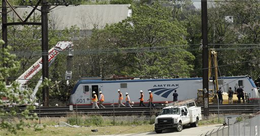 Emergency and transportation personnel work at the scene of a deadly train wreck, Wednesday, May 13, 2015, in Philadelphia. An Amtrak train headed to New York City derailed and crashed in Philadelphia on Tuesday night killing at least seven people and injuring dozens more. (AP Photo/Matt Slocum)
