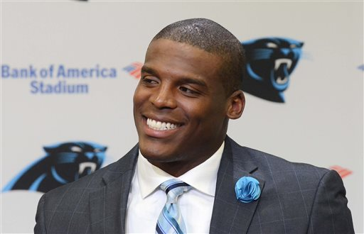 Carolina Panthers quarterback Can Newton speaks to the media during a news conference Tuesday, June 2, 2015, in Charlotte, N.C. Newton has agreed to franchise record $103.8 million, five-year contract extension with the Panthers. Newton will earn $67.6 million over the first three years, the most money ever paid to an NFL player during the first three years of a contract, said a person familiar with negotiations. The person spoke to The Associated Press Tuesday on condition of anonymity because the financial terms of the extension have not been released. (Robert Lahser/The Charlotte Observer via AP)