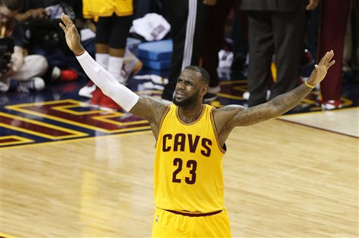 Cleveland Cavaliers forward LeBron James (23) urges on the crowd during the second half of Game 3 of basketball's NBA Finals against the Golden State Warriors in Cleveland, Tuesday, June 9, 2015. (AP Photo/Paul Sancya)