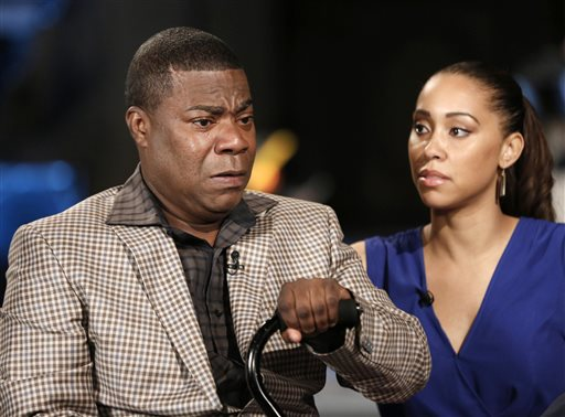 In this photo provided by NBC, actor and comedian Tracy Morgan, left, and fiancee Megan Wollover appear in an interview with Matt Lauer during taping for tonight's Nightly News, Monday, June 1, 2015, in New York.  Morgan spoke out for the first time since his tragic June 2014, car accident. The comedian discussed his memories of the accident, his struggle to recover, and his outlook for the future. (Peter Kramer/NBC News via AP)