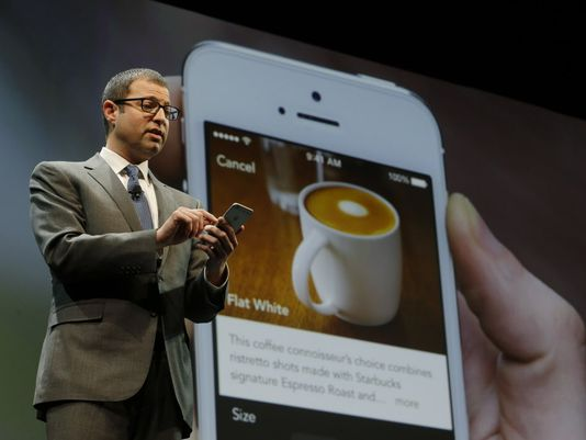 Adam Brotman, Starbucks chief digital officer, talks about the company's new mobile ordering app on March 18, 2015, at Starbucks Coffee Company's annual shareholders meeting in Seattle. The company announced on Tuesday that customers can now order and pay for their drinks ahead of time at 4,000 locations nationwide. (Ted S. Warren/AP Photo)