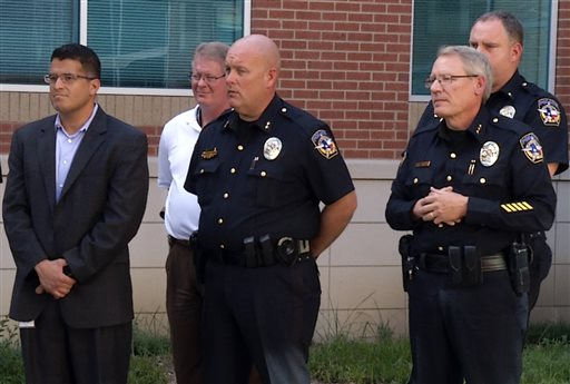 In this frame from video, McKinney law enforcement officials including Police Chief Greg Conley, front right, listen to Mayor Brian Loughmiller during a news conference at police headquarters, Tuesday, June 9, 2015, in McKinney, Texas. The white police officer who was recorded on video pushing a black girl to the ground at a North Texas pool party resigned from the police force Tuesday. (AP Photo/Jill Craig)