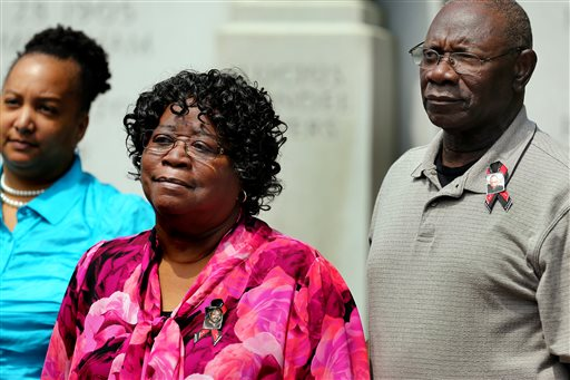 Walter Scott's parents, Judy Scott and Walter Scott Sr., gather with attorneys for Scott's family outside the Charleston County Courthouse, Monday, June 8, 2015, after a Charleston County grand jury handed down an indictment for murder against North Charleston Police Officer Michael Slager in the April 4 shooting death of Walter Scott in Charleston, S.C. Slager fatally shot Scott, who was unarmed, as he was trying to run from a traffic stop. (Grace Beahm/The Post and Courier via AP)
