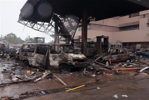 The remaining structure of a gas station after it exploded in Accra, Ghana, Thursday, June 4, 2015. Flooding in Ghana's capital swept stored fuel into a nearby fire, setting off a huge explosion at a gas station that killed dozens of people and set alight neighboring buildings, authorities said Thursday. (AP Photo/Christian Thompson)