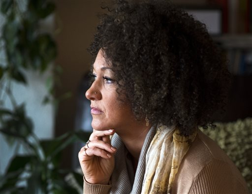 In this March 2, 2015 file photo, Rachel Dolezal, president of the Spokane chapter of the NAACP, poses for a photo in her Spokane, Wash. home. Dolezal is facing questions about whether she lied about her racial identity, with her family saying she is white but has portrayed herself as black, Friday, June 12, 2015. (Colin Mulvany/The Spokesman-Review via AP, File)