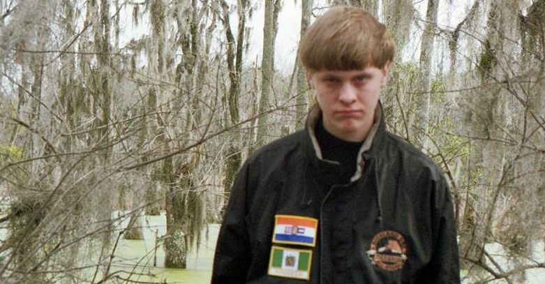 Dylann Roof, 21, pictured here, wearing a jacket with the flags of the former white-racist regimes of South Africa and Rhodesia. (Dylann Roof/Facebook)